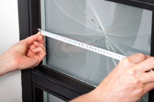 Worker from the Best Window Company in Geneseo IL preparing to repair glass in window