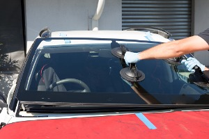 A glass specialist performing Windshield Replacement in Galesburg IL